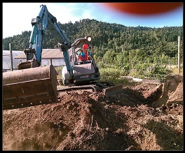 Phoenix School WIT summer camp participant operating heavy machinery. Roseburg, OR